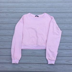 Light pink cropped shirt.